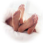 couple_bed_feet.jpg